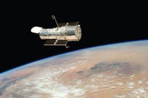 Телескоп Hubble нашел планету, вращающуюся вокруг двух звезд
